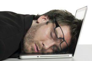 businessman sleeping on his laptop